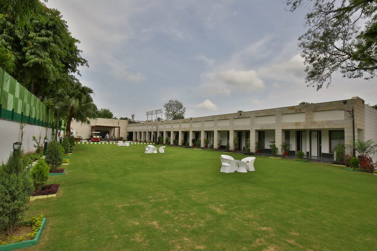 Jhansi Hotel outdoor lawn photograph